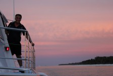 Keith, the skipper admires the pink sky